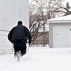 Matt Grotto - For Shaw Media<br /> <br /> A police officer runs through a nearby yard not far from the scene where two women were shot in the 300 block of Emery Avenue in Romeoville, Ill., Thursday, Feb. 13, 2014.