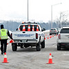 Matt Grotto - For Shaw Media<br /> <br /> Cones are set up for passing traffic on Romeo Rd. as police work at the scene where two women were shot in the 300 block of Emery Avenue in Romeoville, Ill., Thursday, Feb. 13, 2014.