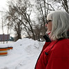 Rob Winner – rwinner@shawmedia.com<br /> <br /> Joliet resident Loretta DeMoss smiles while watching a bald eagle soar over the Des Plaines River near her home on Wednesday, Feb. 12, 2014.