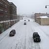 Rob Winner – rwinner@shawmedia.com<br /> <br /> Vehicles travel slowly on West Jefferson Street near North Broadway Street in Joliet, Ill., as snow covers the roads on Monday, Feb. 17, 2014.