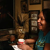 Rob Winner – rwinner@shawmedia.com<br /> <br /> Cynthia Pitchford relaxes with a cup of coffee n the kitchen of her one-bedroom apartment at Des Plaines Garden Homes in Joliet, Ill., Thursday, Feb. 20, 2014. Pitchford has lived in public housing for 32 years, including seven years at her Des Plaines Garden Homes.