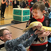 John Patsch  -  For Shaw Media<br /> Dominick Baraico, 9, leans out of the way of a Bremeese Python and Evan Smith, 9, laughs.  The snale was from Traveling World of Reptiles at Cabin Fever at Martino Junior High School in New Lenox.
