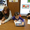Rob Winner – rwinner@shawmedia.com<br /> <br /> Instructor Shannah Kenny (second from left) works with Alaina Wilmouth (from left to right), Sophia Heyl, Emma Varela while working on a shape worksheet during a 2+2=4 year Fun class at the Plainfield Park District on Thursday, Feb. 20, 2014.<br /> <br /> ***The class name is exactly what their online brochure has named it. All of the children in this photo are 4. -Rob***