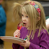 John Patsch  -  For Shaw Media<br /> Clare Janik,5, eats a chocolate covered marshmallow that she made at the Boy Scout Troop 755 both at Martino Junior High School during Cabin Fever sopncered by the New Lenox Police Department.