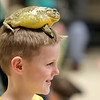 John Patsch  -  For Shaw Media<br /> Ayden Kimball, 8, smiles after Jeremy Toulbee from Traveling World of Reptiles placed a toad on his head.