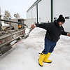 Rob Winner – rwinner@shawmedia.com<br /> <br /> Propane specialist Walter Smith of Heritage FS, Inc. begins to uncoil a hose while make a propane delivery to a farm in Wilmington, Ill., Wednesday, Feb. 12, 2014.