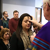 Rob Winner – rwinner@shawmedia.com<br /> <br /> Mariana Salas of Joliet receives ashes from Bishop Joseph Imesch during a service by Catholic Campus Ministry at Joliet Junior College on Wednesday, March 5, 2014.