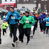John Patsch  -  For Shaw Media<br /> Runners head for the finish at the 5K run at Manhattan's Irish Fest.