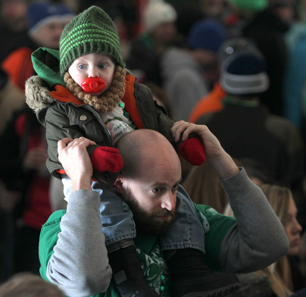 John Patsch  -  For Shaw Media<br /> 16-month-old Reggie Hillary sits on his fater's, Brian, shoulders so he can see the Emerald Society bagpipers at the Manhattan Irish Fest.
