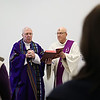 Rob Winner – rwinner@shawmedia.com<br /> <br /> Bishop Joseph Imesch (left) is helped by Deacon James Janousek during a service at Joliet Junior College on Wednesday, March 5, 2014.