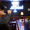 Rob Winner – rwinner@shawmedia.com<br /> <br /> Joliet resident Joe Fitzgerald takes a drink while relaxing at The Department in downtown Joliet on Tuesday, March 11, 2014. The business will be closing at the end of the week.