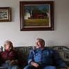 Rob Winner – rwinner@shawmedia.com<br /> <br /> Henry Chavez (left), 79, and Warren Rhind, 77, reminisce about their time at Guy A. Sell Senior Housing Center in New Lenox on Friday, Feb. 28, 2014.