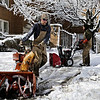 Rob Winner – rwinner@shawmedia.com<br /> <br /> Cal Testin (front) and Mike Liebermann clear snow from a sidewalk near a building located on the corner of West Cambell and North Wilcox streets in Joliet on Wednesday morning.<br /> <br /> Wednesday, March 12, 2014