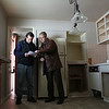 Rob Winner – rwinner@shawmedia.com<br /> <br /> Phil Toth (left) of New Lenox and Mark Meers of Spring Realty look over paperwork at a bank-owned home for sale in Joliet on Thursday, March 6, 2014.