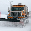 Rob Winner – rwinner@shawmedia.com<br /> <br /> A snow plow truck travels west on Route 52 in Shorewood on Wednesday morning.<br /> <br /> Wednesday, March 12, 2014