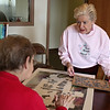 Rob Winner – rwinner@shawmedia.com<br /> <br /> Verona Sawyer (right), 72, and Gloria Browne, 79, have a conversation over a jigsaw puzzle in the community room at the Guy A. Sell Senior Housing Center in New Lenox, Ill., Friday, Feb. 28, 2014. Sawyer was placed on a waiting list to move into the center four years ago and secured a room in November 2013.