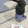 John Patsch for Shaw Media<br /> <br /> Bob Short sets up one of the voting tables for Tuesday's election in New Lenox Township.