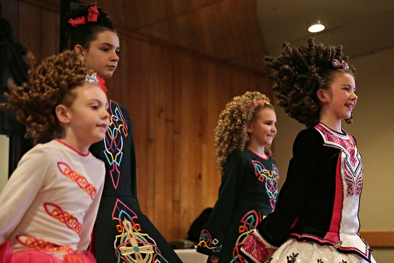 Rob Winner – rwinner@shawmedia.com<br /> <br /> Dancers Shayleigh McNichols (left to right), 7, Grace Schlueter, 12, Katelyn Mullinax, 11, and Anna Cousins, 10, of Keigher Academy of Irish Dance perform for a senior group at Al's Steak House in Joliet, Ill., Thursday, March 13, 2014.