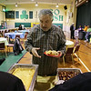 Rob Winner – rwinner@shawmedia.com<br /> <br /> Ken Benco is served breakfast after a service for the hungry at St. Patrick's Church in Joliet, Ill., Saturday, March 15, 2014.