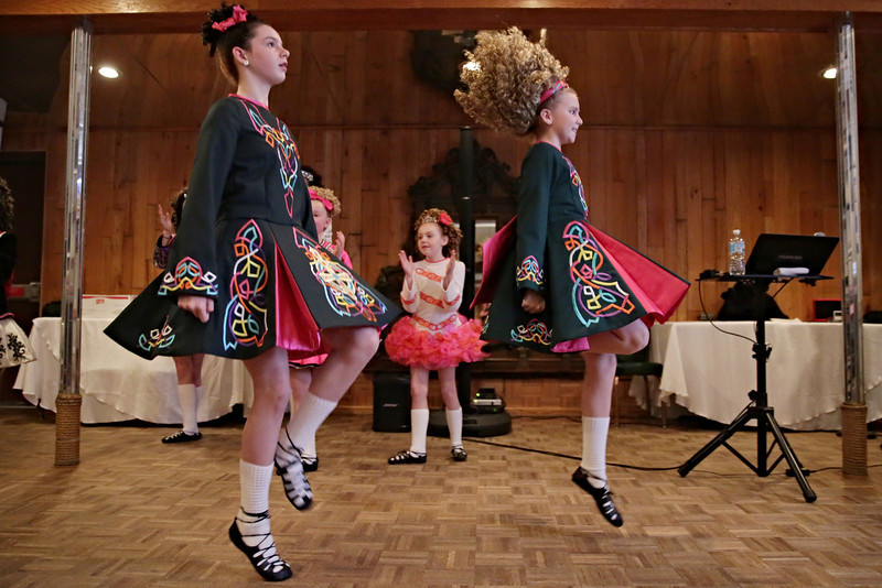 Rob Winner – rwinner@shawmedia.com<br /> <br /> Dancers Grace Schlueter (left), 12, and Katelyn Mullinax, 11, of Keigher Academy of Irish Dance perform for a senior group at Al's Steak House in Joliet, Ill., Thursday, March 13, 2014.