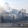 Rob Winner – rwinner@shawmedia.com<br /> <br /> Firefighters work to extinguish a fire that destroyed a home located at 777 Lambeth Lane in Joliet, Ill., Monday, March 24, 2014.