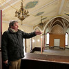 Rob Winner – rwinner@shawmedia.com<br /> <br /> Plainfield village planner Michael Garrigan gives a tour of the old church building located at 24018 West Lockport Street on Wednesday, March 19, 2014. The Village of Plainfield, which now owns the building, hopes the building will be bought and once again converted into a restaurant.