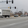 Rob Winner – rwinner@shawmedia.com<br /> <br /> A funeral procession is seen following a semitrailer on Route 53 passing Walter Strawn Drive while traveling to Abraham Lincoln National Cemetery in Elwood, Ill., Tuesday, March 25, 2014.
