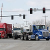 Rob Winner – rwinner@shawmedia.com<br /> <br /> Tractor-trailers are seen turning onto Route 53 from Walter Strawn Drive in Elwood, Ill., Tuesday, March 25, 2014.