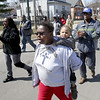 John Patsch - For Shaw Media<br /> Doreen Williams carries her 4-year-old grandson, Jaylen Williams during the peach march sponcered by the Forrest Park Community center.
