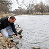 Rob Winner – rwinner@shawmedia.com<br /> <br /> Wilmington resident Shawn Hill uses a thermometer to check the temperature of the DuPage River at West Shore Park in Sherwood, Ill., Monday, March 31, 2014. Hill, who fishes for small and largemouth bass, described the area as a jewel in Will County.