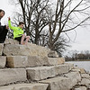 Rob Winner – rwinner@shawmedia.com<br /> <br /> Shorewood residents Lori Motsch and her son, Jimmy Motsch, 9, attempt to skip stones in the DuPage River at West Shore Park in Shorewood on Monday afternoon.<br /> <br /> Monday, March 31, 2014<br /> Shorewood, Ill.
