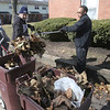 John Patsch - For Shaw Media<br /> Roy Finley and HAJ Driector Michael Simelton clean up a parking lot at the Des Plaines Gardens housing complex during a volunteer clean-up day.