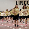 Rob Winner – rwinner@shawmedia.com<br /> <br /> Adaptive physical education leader Katelyn Lowery (left), 18, and Elizabeth Limanowski, 16, run together on the track inside the field house at Lincoln-Way North High School in Frankfort Friday afternoon. Lowery is one of the eight local 2014 Golden Apple Scholars, a program that fosters young educators and provides tuition assistance for college.