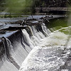 Rob Winner – rwinner@shawmedia.com<br /> <br /> Water from Hickory Creek pours over the Pilcher Park Dam in Joliet on Tuesday, April 22, 2014.