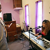 Rob Winner – rwinner@shawmedia.com<br /> <br /> Pastor Kenneth Coleman (left) uses a smart phone to record his daughter, Taylor Coleman, playing the piano and singing at the City of Refuge Pentecostal Church in Lockport Friday, May 2, 2014.