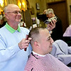Rob Winner – rwinner@shawmedia.com<br /> <br /> John Mooore uses clippers to cut C.J. Almeida's hair at Plaza Barber Shop in Shorewood, Ill., Friday, May 2, 2014.