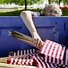 Rob Winner – rwinner@shawmedia.com<br /> <br /> On Friday, Schererville resident Rita Luczak returns a bundle of flags to a bin after volunteers finished placing a flag in front of each grave at Abraham Lincoln National Cemetery ahead of Monday's Memorial Day event in Elwood. Luczak's son, Dan Luczak, who served in the Navy was buried at the cemetery three years ago.<br /> <br /> Friday, May 23, 2014<br /> Elwood, Ill.