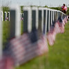 Rob Winner – rwinner@shawmedia.com<br /> <br /> Carol Becker of Joliet and Ray Hannan of Lockport work together to place flags on the graves of veterans at Abraham Lincoln National Cemetery in Elwood on Friday morning.<br /> <br /> Friday, May 23, 2014<br /> Elwood, Ill.