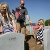 Rob Winner – rwinner@shawmedia.com<br /> <br /> On Friday morning, Shorewood residents Jocelyn DeLaney (left), 6, and Adelyn DeLaney, 3, place flags on the graves of veterans with their father, Sean DeLaney, at Abraham Lincoln National Cemetery ahead of Monday's Memorial Day event in Elwood.<br /> <br /> Friday, May 23, 2014<br /> Elwood, Ill.