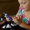 Rob Winner – rwinner@shawmedia.com<br /> <br /> Abby Genens, 4, pokes her finger to test her blood sugar level before lunch at her family's Manhattan home Friday, May 30, 2014. Abby Genens was diagnosed with type 1 diabetes February 2011.