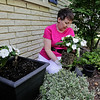 "Rob Winner – rwinner@shawmedia.com<br /> <br /> Dianne Morr arranges a flower pot while gardening in front of her Naperville home on Tuesday, June 3, 2014. Morr beat anxiety and depression by focusing on happiness and wrote a book about it titled, ""Choose Happy: 25 Happiness Habits to Transform Your Life."""