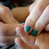 Rob Winner – rwinner@shawmedia.com<br /> <br /> Melanie Cabeen helps her daughter, Abby Genens, squeeze a drop of blood from her fingertip to check Abby's blood sugar levels before lunch at their Manhattan home Friday, May 30, 2014.