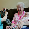 Rob Winner – rwinner@shawmedia.com<br /> <br /> Brayden Brockman, 3, plays with a toy dinosaur as his grandmother Barbara Brockman watches while holding Brayden's 7-week-old brother, Jaxsen Brockman, in Wilmington Wednesday, June 4, 2014. Barbara Brockman had a stent placed into a partially blocked heart artery during a non-surgical procedure at Presence Saint Joseph Medical Center to help increase blood flow.