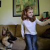Rob Winner – rwinner@shawmedia.com<br /> <br /> Madelynn Panti, 10, and her mother Suzanne Pridemore work on training their German shepherd service dog, Enzi, at their home in Morris Thursday, June 5, 2014. Madelynn has cerebral palsy and cortical vision impairment.