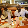 Rob Winner – rwinner@shawmedia.com<br /> <br /> Marzell Green (right) orders a Belgian waffle while taking his family out to breakfast at Big Apple Pancake House in Joliet Friday, June 13, 2014. Marzell works evenings, plays semi-pro football, is raising his 8-year-old son and helps take care of his father and brother.