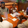 Rob Winner – rwinner@shawmedia.com<br /> <br /> Dazhon Green (second from right), 8, pauses for a moment while answering a question asked by his father Marzell Green (left), while having breakfast at Big Apple Pancake House in Joliet Friday, June 13, 2014. Marzell works evenings, plays semi-pro football, is raising his son and helps take care of his father, Charles (right), and brother, Jorge (second from left).