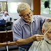 Rob Winner – rwinner@shawmedia.com<br /> <br /> Earl Fischer (right) of Joliet receives a haircut from Joe Ragusa of Joe Ragusa's Barber Shop in Joliet Monday, June 16, 2014. Joe and his brother Dom (left) will be closing the shop opened in 1955 by their father, Joe Ragusa Sr., this coming Saturday.