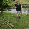 Rob Winner – rwinner@shawmedia.com<br /> <br /> Local artist John Siblik is seen near the I&M Canal near Ninth Street while constructing arches made from tree branches for an installation on Tuesday, June 10, 2014.