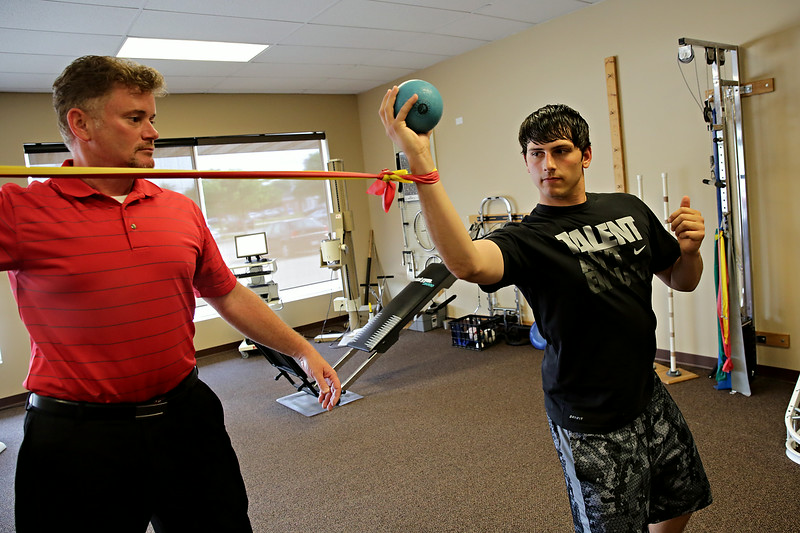 Rob Winner – rwinner@shawmedia.com<br /> <br /> Physical therapist Jeff Lyon (left) works with Anthony DiNardo at Newsome & Smith Physical Therapy Center in Shorewood Thursday, June 19, 2014.