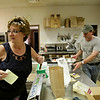 Rob Winner – rwinner@shawmedia.com<br /> <br /> Diana Wysocki (left) and her husband Ed Wysocki work on filling orders in the kitchen of Pub Grub at American Legion Post 1080 in Joliet on Wednesday, June 18, 2014.